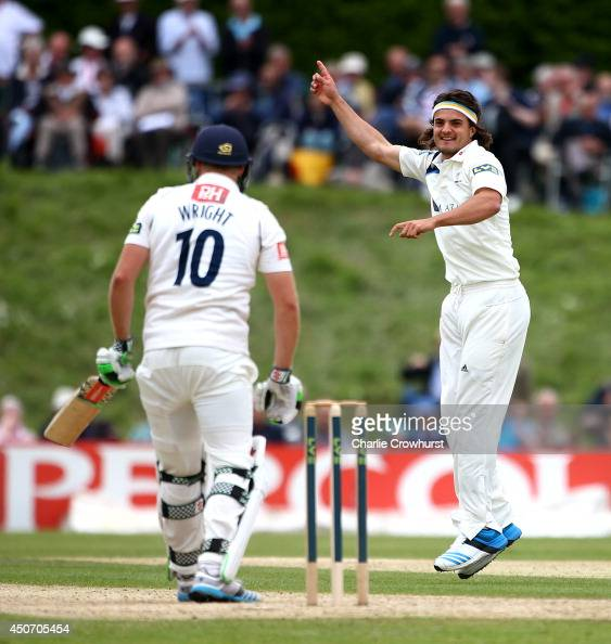 Jack Brooks of Yorkshire celebrates taking the wicket of Luke Wright of Sussex during day one of the LV County Championship match between Sussex and...