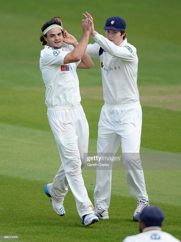 Jack Brooks of Yorkshire celebrates with Ryan Gibson after dismissing Maurice Chambers of Northamptonshire during day four of the LV County Championship division One match between Yorkshire and Northamptonshire at Headingley on April 23, 2014 in Leeds, England.