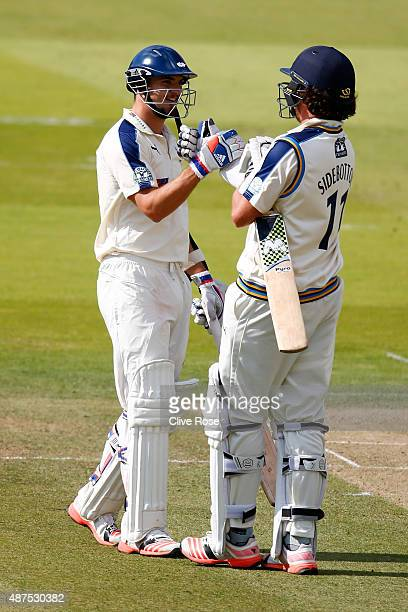 Jack Brooks of Yorkshire is congratulated by Ryan Sidebottom on his his half century during the LV County Championship between Middlesex and...