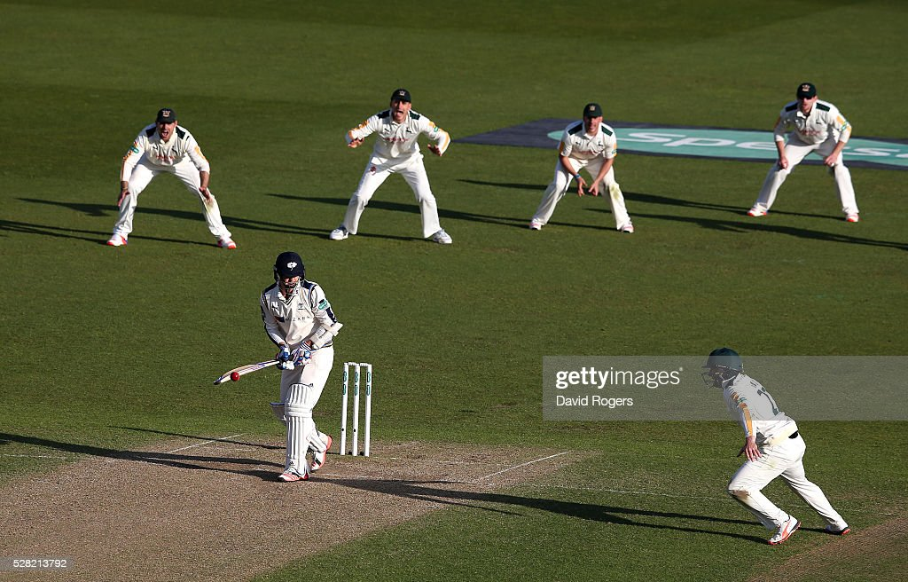 Jack Brooks of Yorkshire plays the ball but it falls short of the close fielders to ensure a draw during the Specsavers County Championship division one match between Nottinghamshire and Yorkshire at Trent Bridge on May 4, 2016 in Nottingham, England.