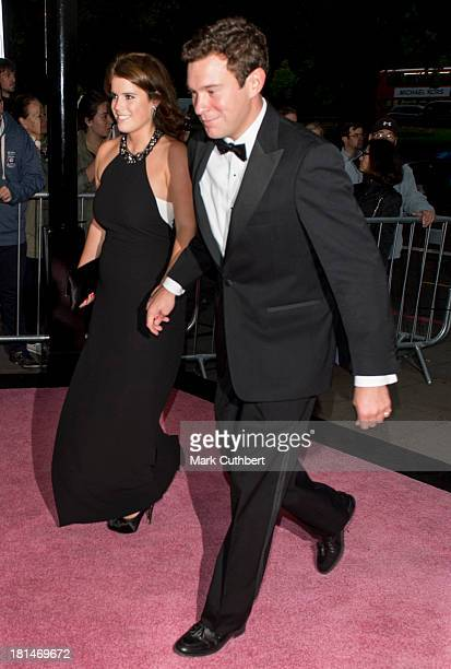 Jack Brooksbank and Princess Eugenie arrive at The Boodles Boxing Ball at The Grosvenor House Hotel on September 21 2013 in London England