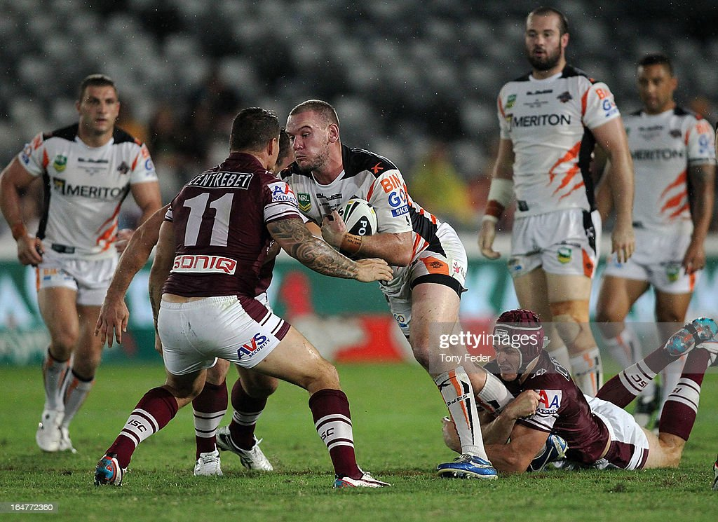 <a gi-track='captionPersonalityLinkClicked' href=/galleries/search?phrase=Jack+Buchanan&family=editorial&specificpeople=731294 ng-click='$event.stopPropagation()'>Jack Buchanan</a> of the Wests Tigers breaks through Sea Eagles defence during the round four NRL match between the Manly Sea Eagles and the Wests Tigers at Bluetongue Stadium on March 28, 2013 in Gosford, Australia.