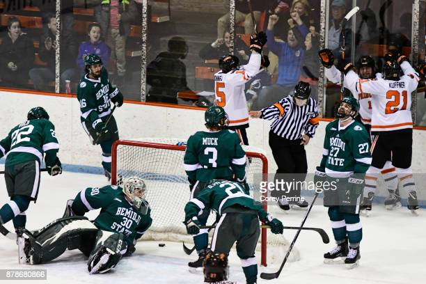 Jack Burgart of the Bemidji State Beavers eyes the second goal putting them ahead from the Princeton Tigers late in the second period at Hobey Baker...