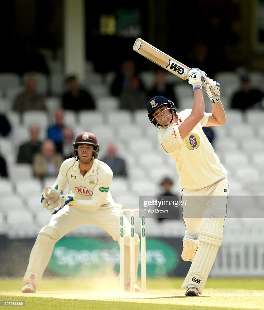 Jack Burnham of Durham bats watched by Ben Foakes of Surrey during day three of the Specsavers County Championship Division One match between Surrey and Durham at the Kia Oval on May 3, 2016 in London, England.