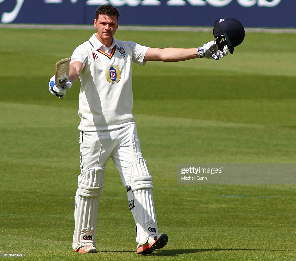 Jack Burnham of Durham celebrates scoring his maiden century during the Specsavers County Championship Division One match between Surrey and Durham at the Kia Oval Cricket Ground, on May 03, 2016 in London, England.
