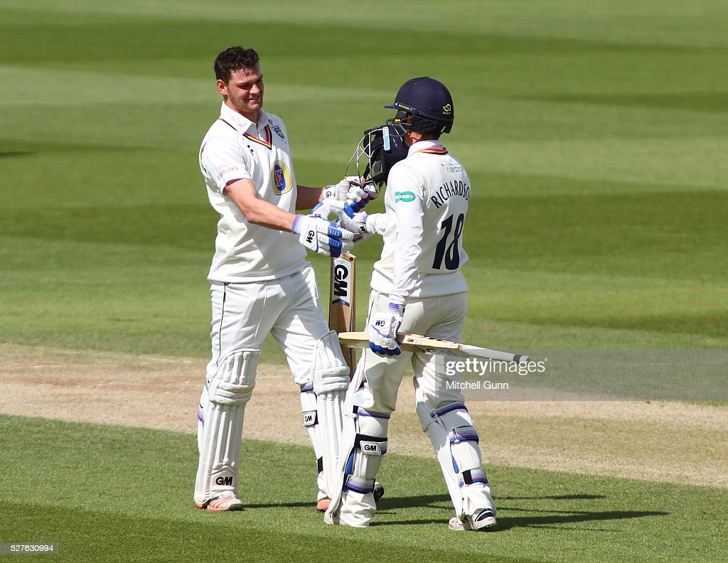 Jack Burnham of Durham celebrates scoring his maiden century with Michael Richardson during the Specsavers County Championship Division One match between Surrey and Durham at the Kia Oval Cricket Ground, on May 03, 2016 in London, England.