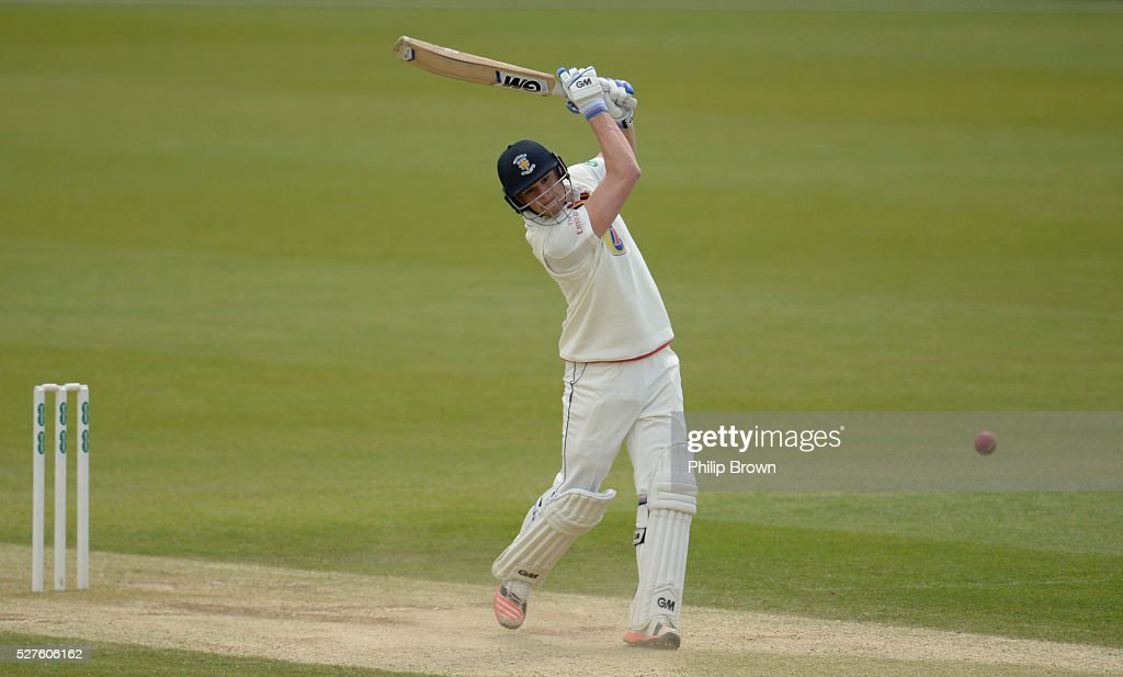 Jack Burnham of Durham hits a four during day three of the Specsavers County Championship Division One match between Surrey and Durham at the Kia Oval on May 3, 2016 in London, England.