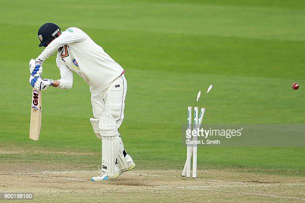 Jack Burnham of Durham is bowled by Ryan Sidebottom of Yorkshire during Day Three of the Specsavers County Championship Division One match between...