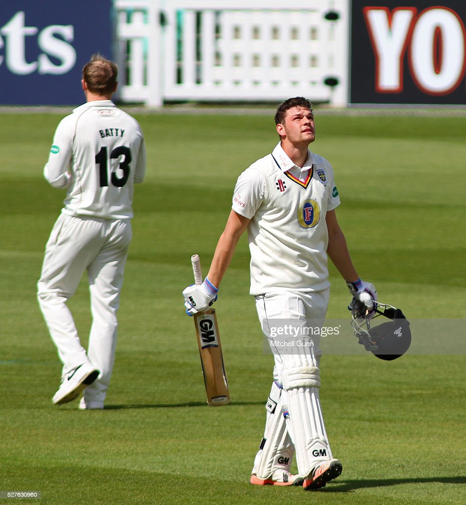 Jack Burnham of Durham looks to the sky as he celebrates scoring his maiden century during the Specsavers County Championship Division One match between Surrey and Durham at the Kia Oval Cricket Ground, on May 03, 2016 in London, England.