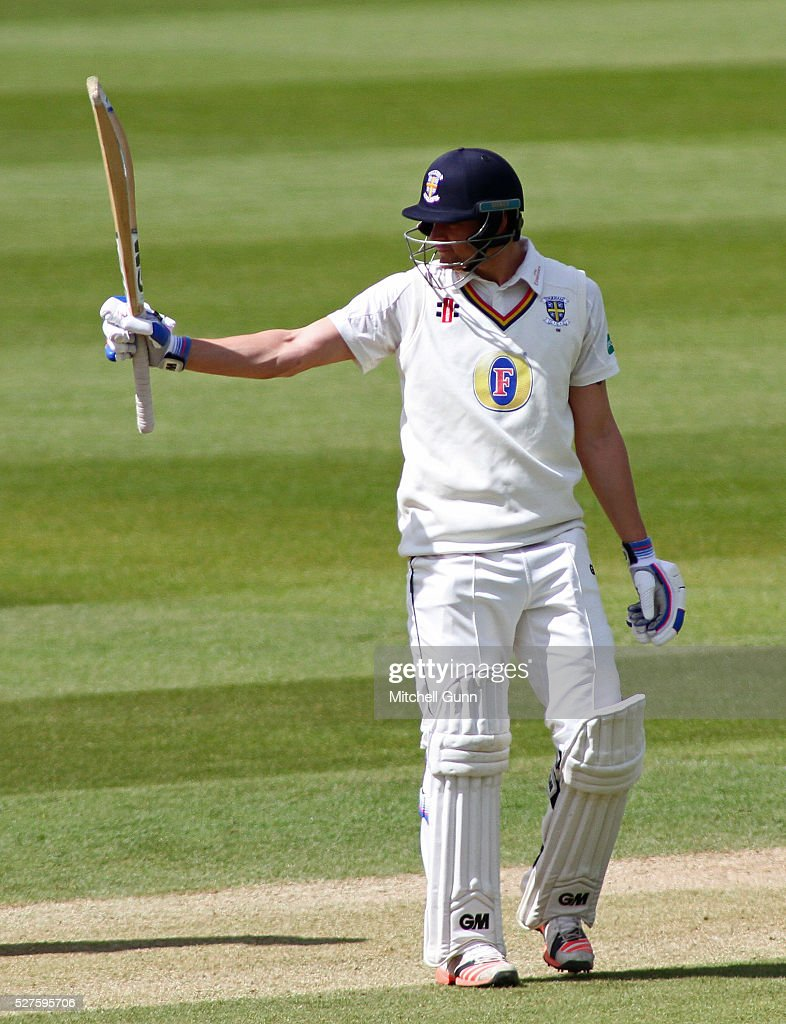 Jack Burnham of Durham raises his bat and celebrates scoring a half century during the Specsavers County Championship Division One match between Surrey and Durham at the Kia Oval Cricket Ground, on May 03, 2016 in London, England.