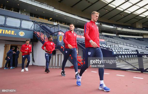 Jack Butland and Joe Hart of England walk on the pitch on the eve of their FIFA World Cup qualifier against Scotland at Hampden Park on June 9 2017...