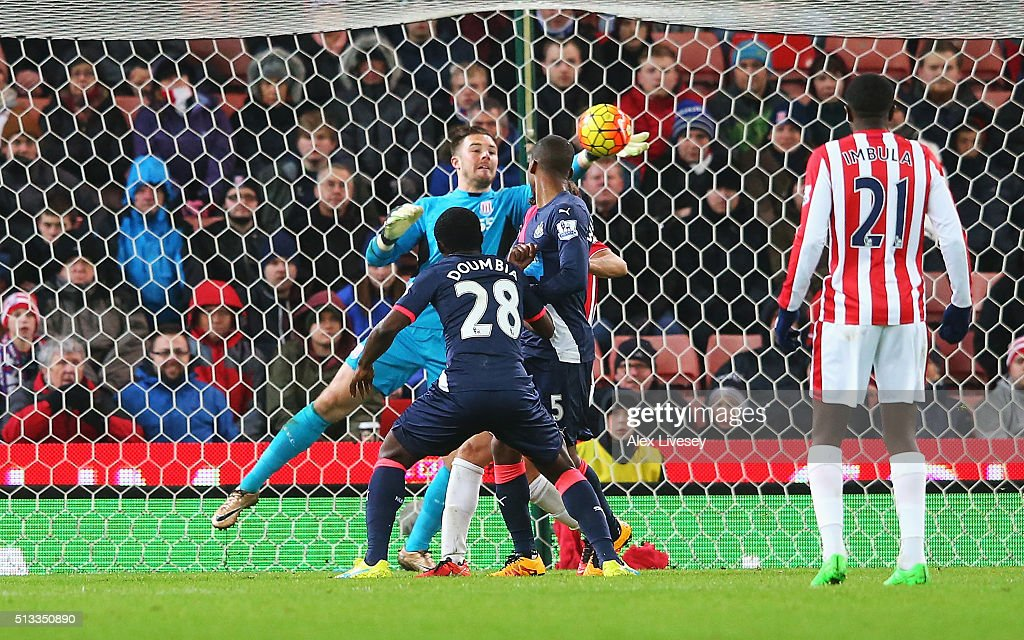 Jack Butland goalkeeper of Stoke City makes a late save from Seydou Doumbia of Newcastle United during the Barclays Premier League match between Stoke City and Newcastle United at the Britannia Stadium on March 2, 2016 in Stoke on Trent, England.