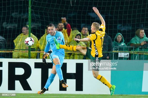 Jack Butland of England and Ovidijus Verbickas of Lithuania during the FIFA 2018 World Cup Qualifier between Lithuania and England on October 8 2017...
