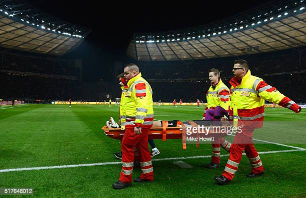 Jack Butland of England is taken off the pitch by a stretcher after injury during the International Friendly match between Germany and England at...
