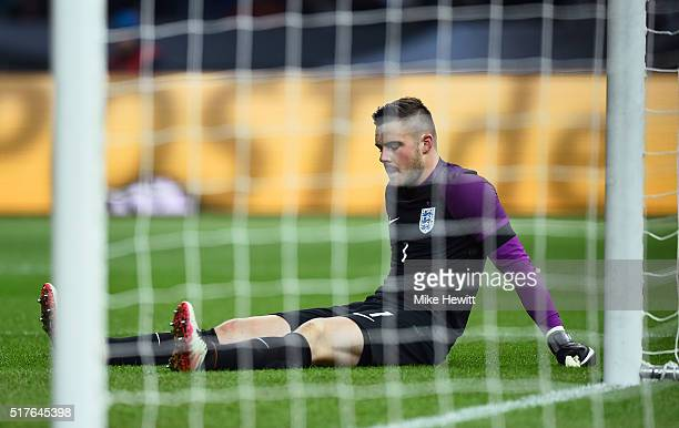 Jack Butland of England lies on the pitch as he gets injured during the International Friendly match between Germany and England at Olympiastadion on...