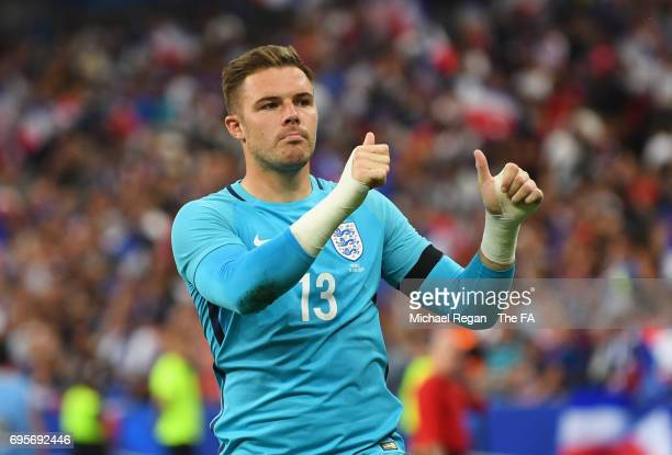 Jack Butland of England salutes the travelling fans in defeat after the International Friendly match between France and England at Stade de France on...