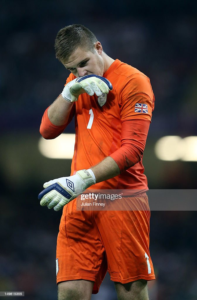 Jack Butland of Great Britain looks dejected after their penalty shoot out loss during the Men's Football Quarter Final match between Great Britain and Korea, on Day 8 of the London 2012 Olympic Games at Millennium Stadium on August 4, 2012 in Cardiff, Wales.