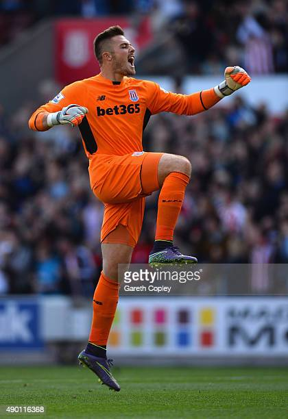 Jack Butland of Stoke City celebrates his team's first goal by Jonathan Walters during the Barclays Premier League match between Stoke City and AFC...