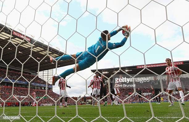 Jack Butland of Stoke City makes a save during the Barclays Premier League match between Stoke City and Liverpool at Brittania Stadium on August 9...