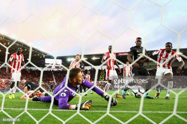 Jack Butland of Stoke City makes a save during the Premier League match between Stoke City and Manchester United at Bet365 Stadium on September 9...