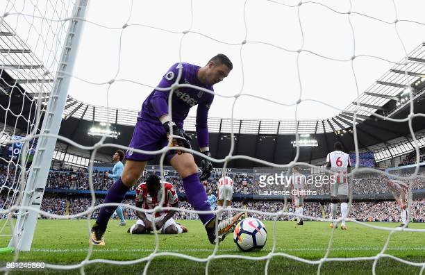 Jack Butland of Stoke City picks the ball out of the net after a goal during the Premier League match between Manchester City and Stoke City at...