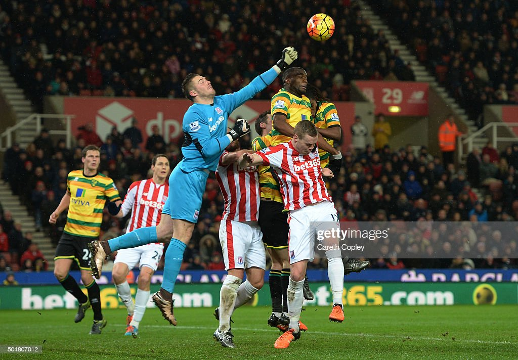 Jack Butland of Stoke City punches the ball during the Barclays Premier League match between Stoke City and Norwich City at the Britannia Stadium on January 13, 2016 in Stoke on Trent, England.
