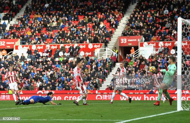 Jack Butland of Stoke City saves a shot from Shinji Okazaki of Leicester City during the Premier League match between Stoke City and Leicester City...