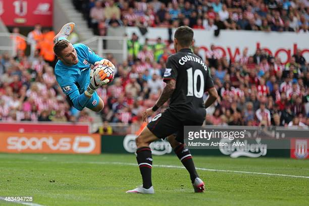 Jack Butland of Stoke City saves from a header from Martin Skrtel of Liverpool with Philippe Coutinho waiting to pounce during the Barclays Premier...