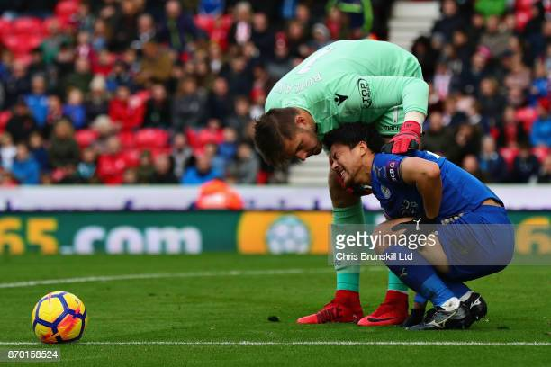 Jack Butland of Stoke City talks with Shinji Okazaki of Leicester City during the Premier League match between Stoke City and Leicester City at...