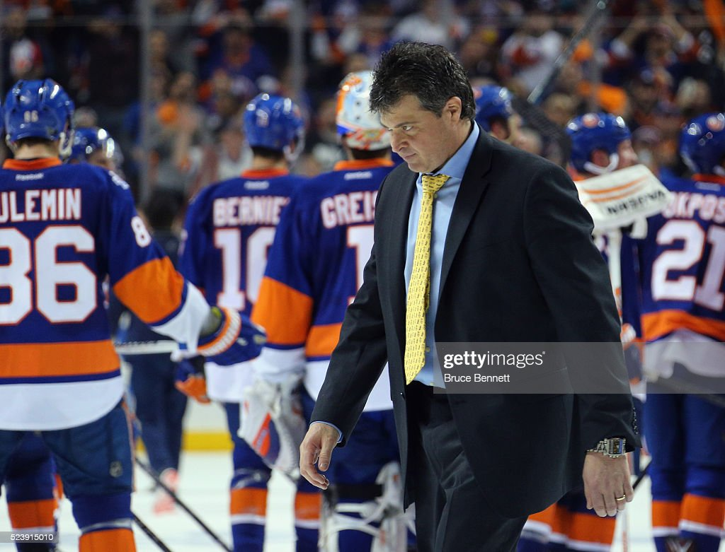 Jack Capuano of the New York Islanders leaves the ice following a 21 victory over the Florida Panthers in Game Six of the Eastern Conference First...