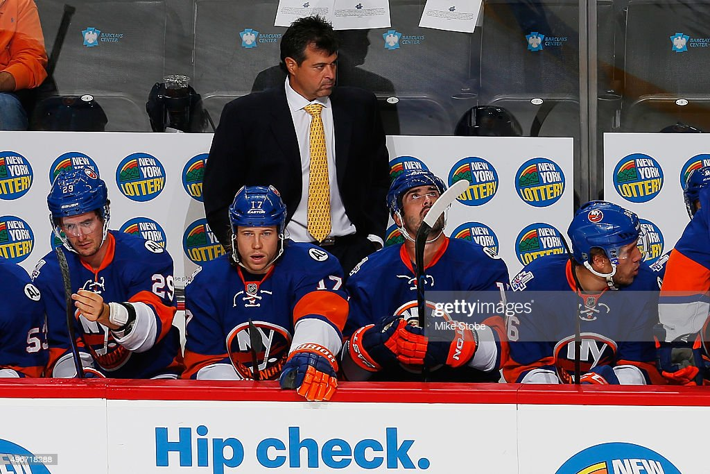 Jack Capuano of the New York Islanders looks on against the Chicago Blackhawks at the Barclays Center on October 9 2015 in Brooklyn borough of New...