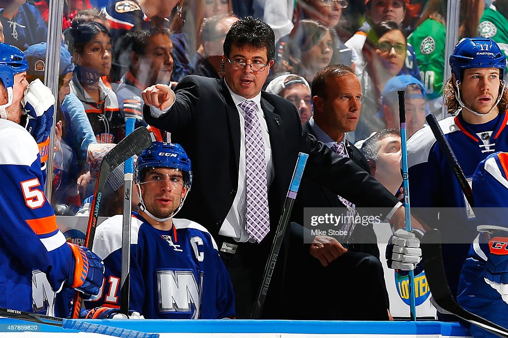 Jack Capuano of the New York Islanders wears a purple tie in support of Hockey Fights Cancer during a game against the Dallas Stars at Nassau...
