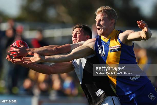 Jack Charleston of Williamstown and Matt Austin of North Ballarat compete for the ball during the round nine VFL match between Williamstown and North...