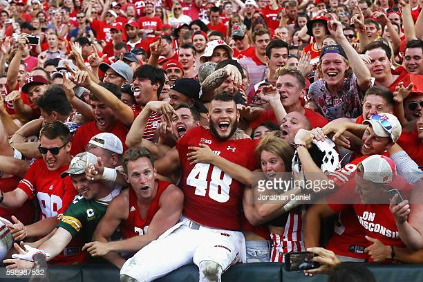 Jack Cichy of the Wisconsin Badgers celebrates with fans after defeating the LSU Tigers 1614 at Lambeau Field on September 3 2016 in Green Bay...