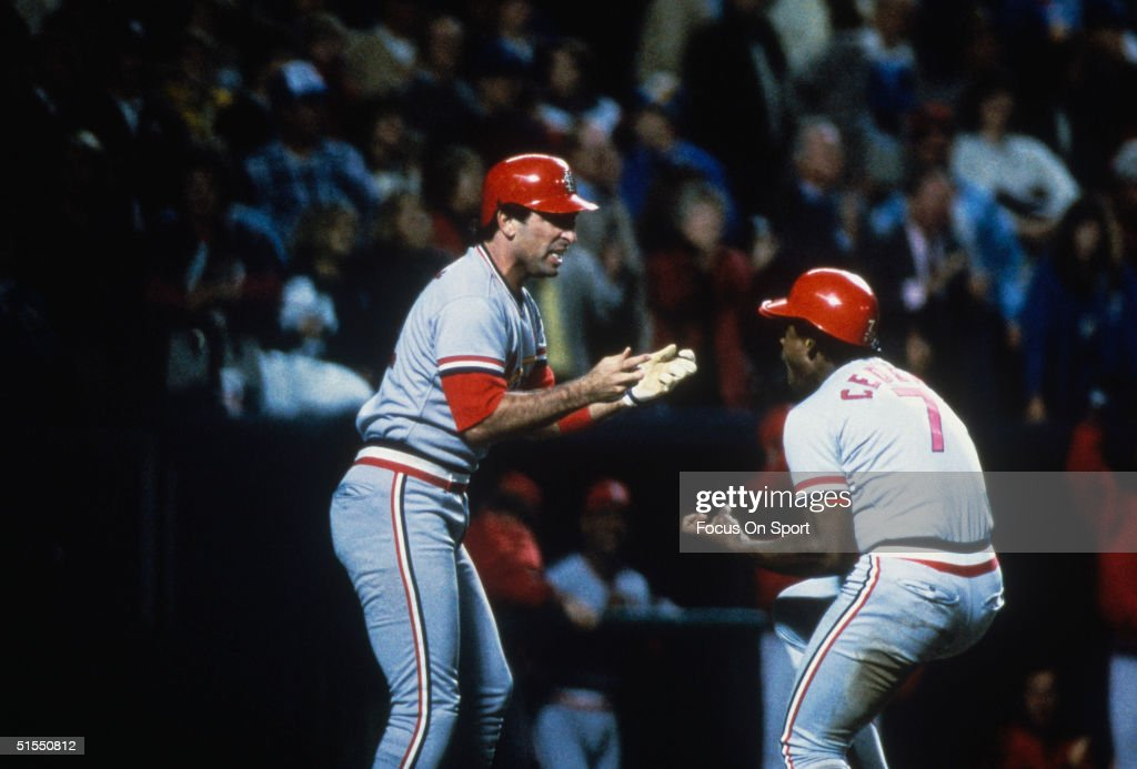 Jack Clark and Cesar Cedeno of the St Louis Cardinals enjoy a moment during the World Series against the Kansas City Royals at Royals Stadium on...