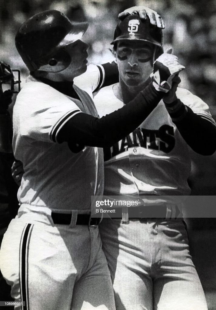 Jack Clark and teammate Darrell Evans of the San Francisco Giants celebrate after Clark his a two run home run during their game against the...