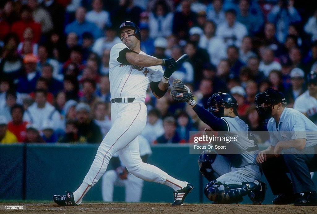 Jack Clark of the Boston Red Sox bats against the New York Yankees during an MLB baseball game at Fenway Park circa 1991 in Boston Massachusetts...