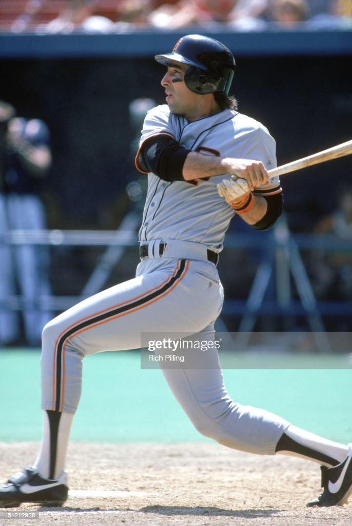 Jack Clark of the San Francisco Giants watches the flight of the ball as he follows through on a swing during a MLB season game Jack Clark played for...