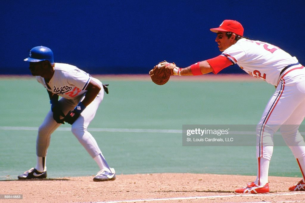 Jack Clark of the St Louis Cardinals holds his glove out for a pickoff play during a game against the Los Angeles Dodgers during the 1985 season at...