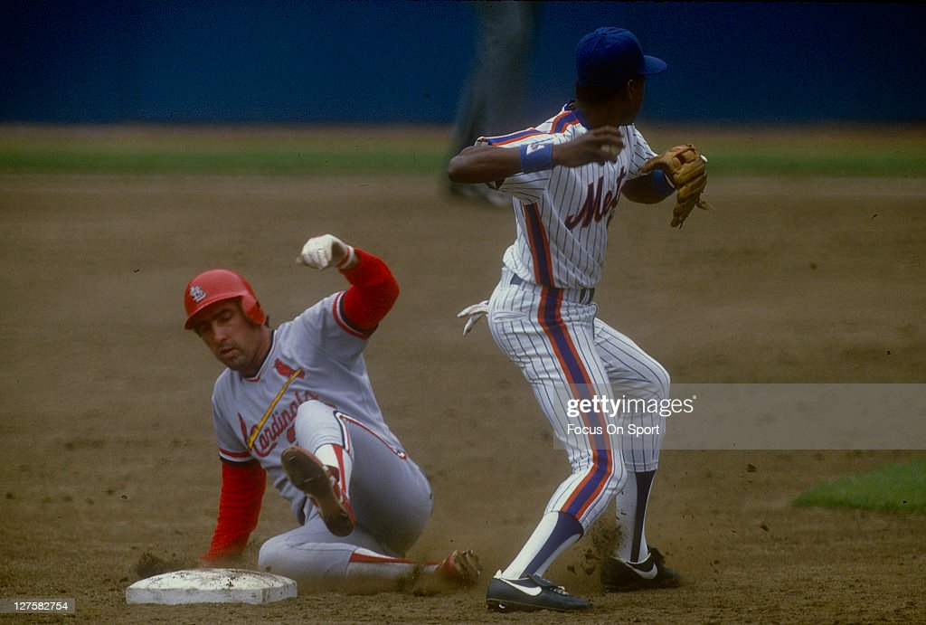 Jack Clark of the St Louis Cardinals slides into second base against the New York Mets during an MLB baseball game at Shea Stadium circa 1987 in the...