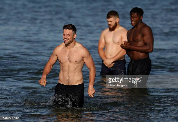 Jack Clifford leads his team mates Luke CowanDickie and Maro Itoje out of the ocean during the England recovery session held at St Kilda Beach on...