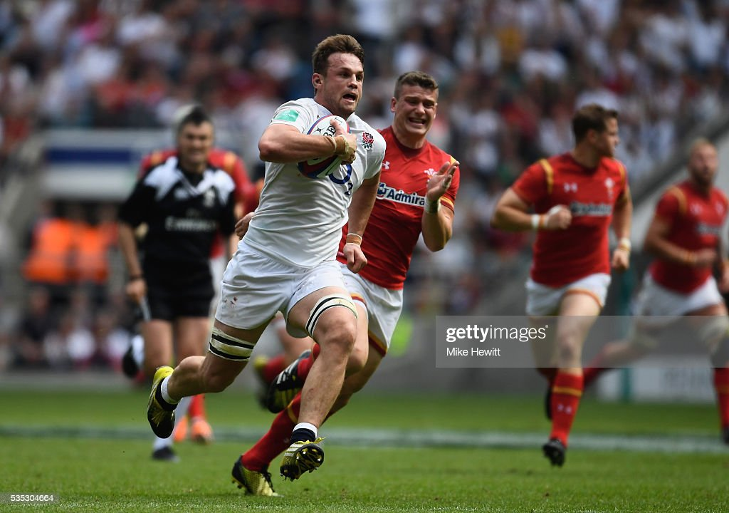 <a gi-track='captionPersonalityLinkClicked' href=/galleries/search?phrase=Jack+Clifford+-+Rugby+Union+Player&family=editorial&specificpeople=15452215 ng-click='$event.stopPropagation()'>Jack Clifford</a> of England breaks wawy to score a try during the Old Mutual Wealth Cup between England and Wales at Twickenham Stadium on May 29, 2016 in London, England.
