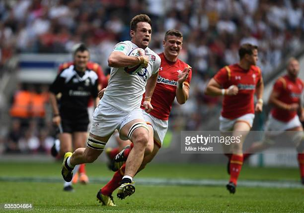 Jack Clifford of England breaks wawy to score a try during the Old Mutual Wealth Cup between England and Wales at Twickenham Stadium on May 29 2016...