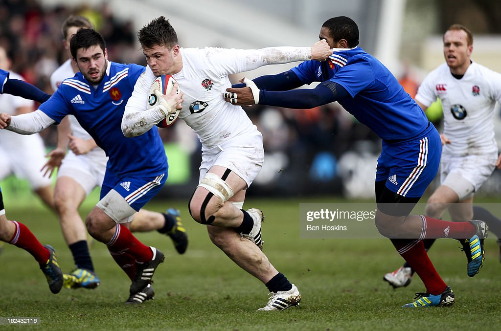 Jack Clifford of England hands off the tackle of Mathieu Babillot of France during the U20s RBS Six Nations match between England U20 and France U20 at the Sixways Stadium on February 23, 2013 in Worcester, England.
