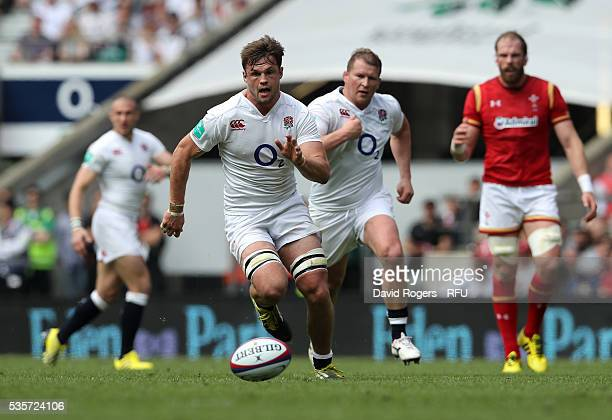 Jack Clifford of England kicks the ball upfield during the England v Wales International match at Twickenham Stadium on May 29 2016 in London England