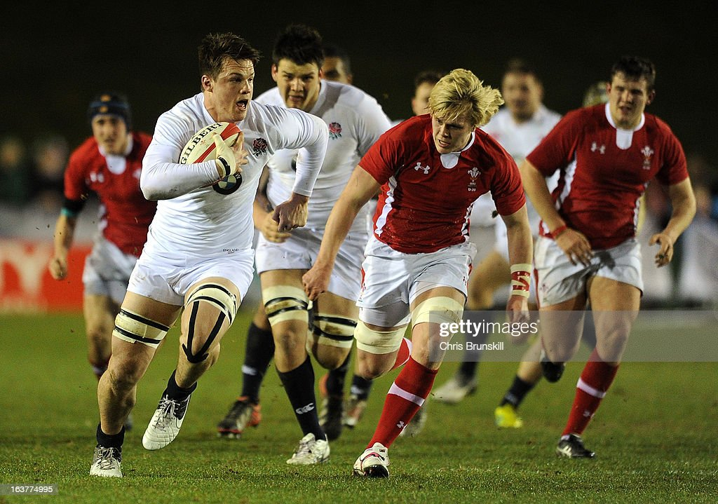 Jack Clifford of England U20 races clear of Daniel Thomas of Wales U20 during the match between Wales U20 and England U20 at Eirias Park on March 15, 2013 in Colwyn Bay, Wales.