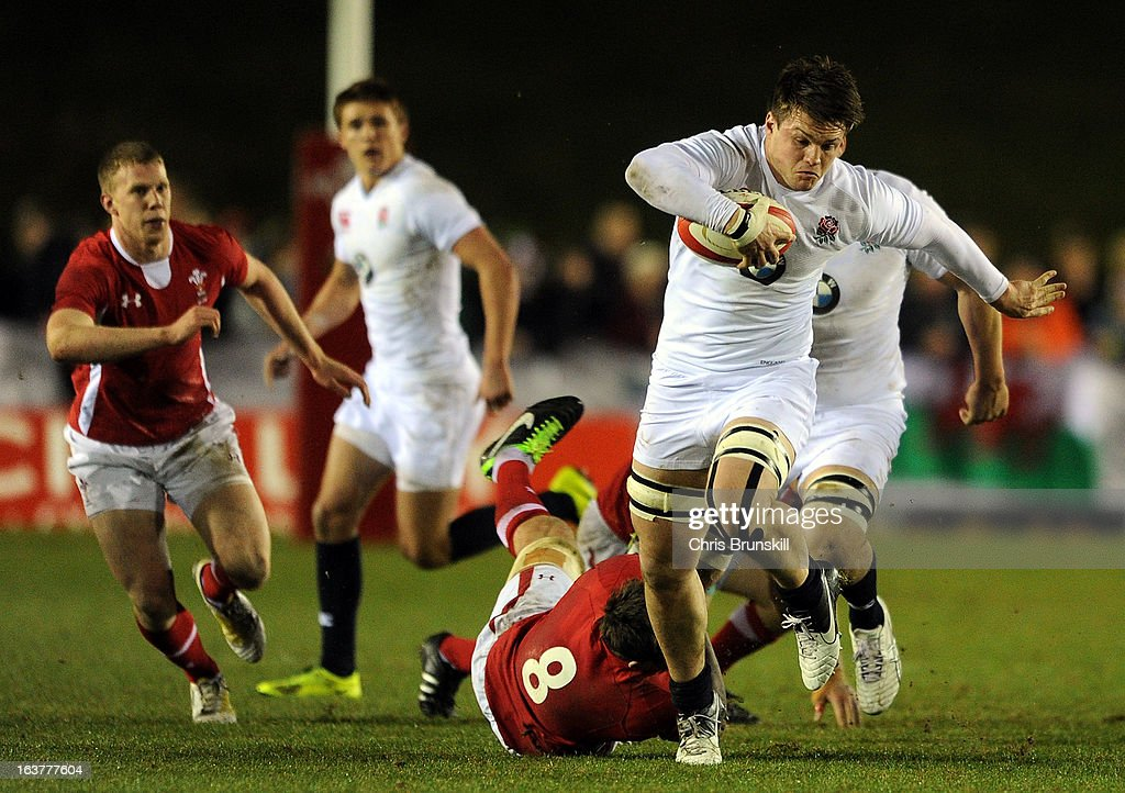 Jack Clifford of England U20 races clear of Ieuan Jones of Wales U20 during the match between Wales U20 and England U20 at Eirias Park on March 15, 2013 in Colwyn Bay, Wales.