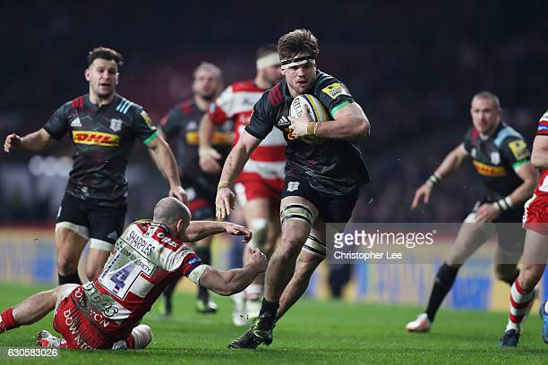 Jack Clifford of Harlequins breaks past Charlie Sharples of Gloucester to score his team's second try during the Aviva Premiership Big Game 9 match...