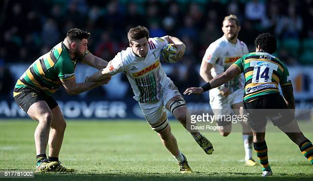 Jack Clifford of Harlequins charges upfield to score a try during the Aviva Premiership match between Northampton Saints and Harlequins at Franklin's...