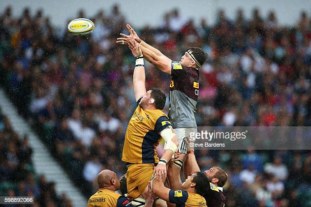 Jack Clifford of Harlequins wins a lineout ball from James Phillips of Bristol Rugby during the Aviva Premiership match between Harlequins and...